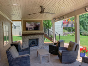outside room under a deck with a TV